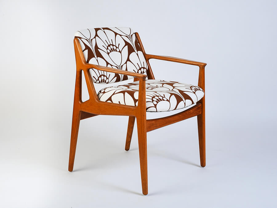 Danish swing back arm chair in bold modern print