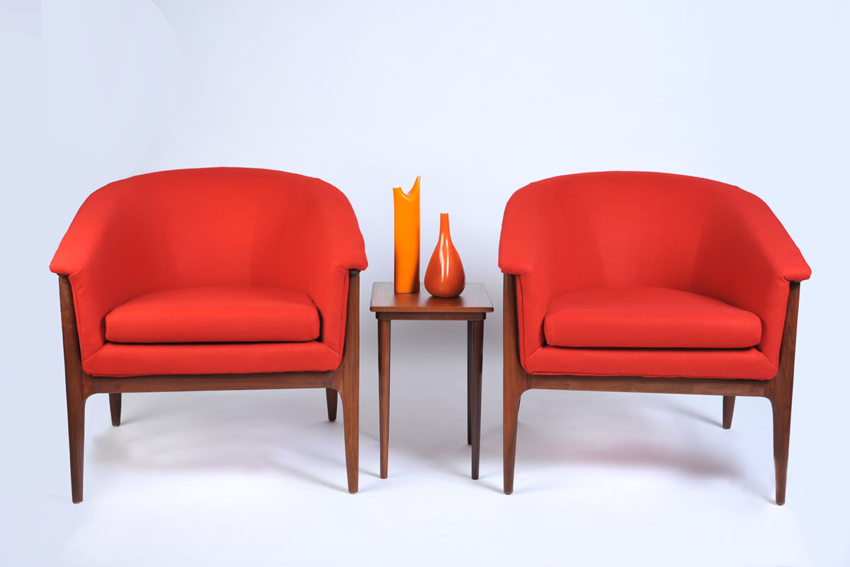 Matching pencil legged arm chairs in Maharam Divina by Kvadrat