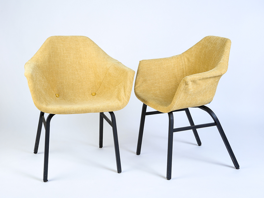Eames chairs draped in a soft weave